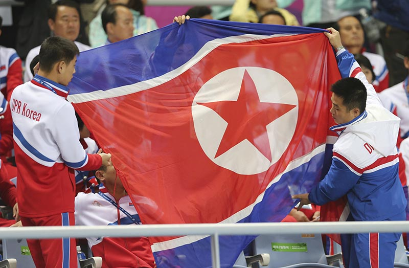 FILE - North Korea's delegation members prepare to spread the North Korean flag during their women's soccer final match at the 17th Asian Games in Incheon, South Korea, on October 1, 2014. Photo: AP