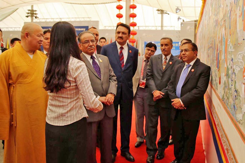 PM Pushpa Kamal Dahal, who is in China to attend the Boao Forum for Asia Annual Conference 2017, observes a Thangka painting in Hainan province on Friday, March 24, 2017. Courtesy: PM Secretariat