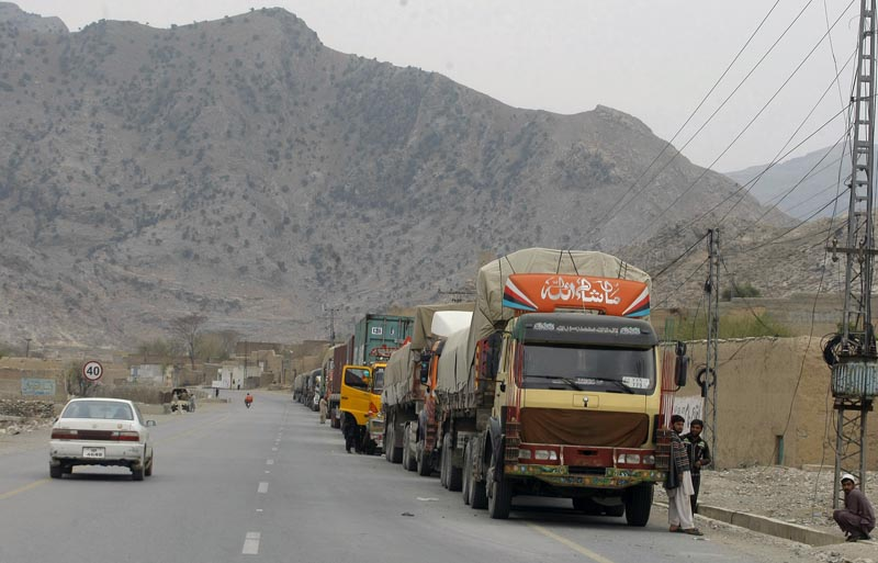 Truck drivers stand beside their trucks while they waiting for border opening at a highway leading to Torkhum, a border crossing between Pakistan Afghanistan, Monday, March, 20, 2017. Photo: AP