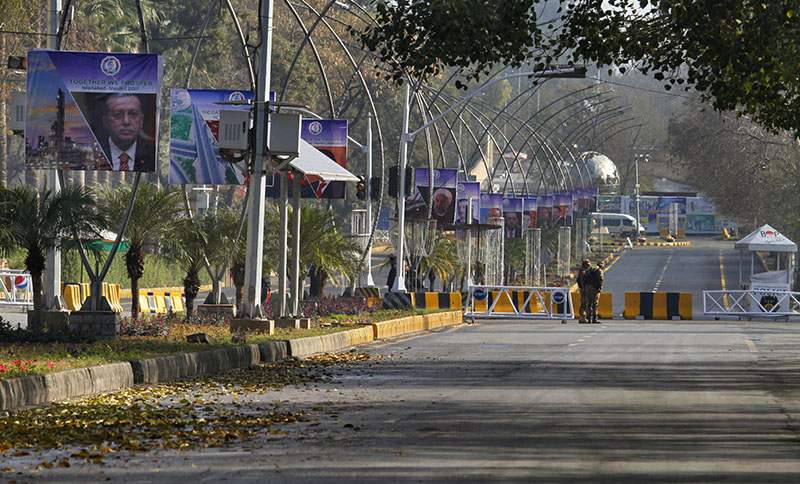 Pakistani army soldiers stand guard at a barricaded road leading to the venue of the Economic Cooperation Organisation summit in Islamabad, Pakistan, on Wednesday, March 1, 2017. Photo: AP