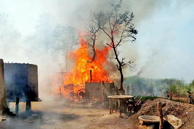 A flame of fire is seen as it rages through houses at Bageshwori, in Parsa district, on Tuesday, March 7, 2017. Photo: Ram Sarraf