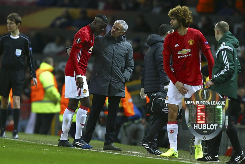 United manager Jose Mourinho, center, talks with United's Paul Pogba as he is substituted by Marouane Fellaini during the Europa League round of 16, second leg, soccer match between Manchester United and FC Rostov at Old Trafford Stadium in Manchester, England, on Thursday March 16, 2017. Photo: AP