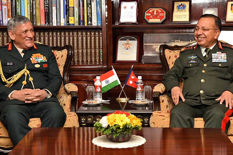 Chief of Army Staff Rajendra Chhetri interacts with his Indian counterpart Bipin Rawat at the Nepal Army Headquarters in Kathmandu, on Wednesday, March 29, 2017. Photo Courtesy: NA
