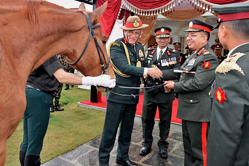 Chief of Army Staff Rajendra Chhetri receives a horse from his Indian counterpart Bipin Rawat at the Nepal Army Headquarters in Kathmandu, on Wednesday, March 29, 2017. Photo Courtesy: NA