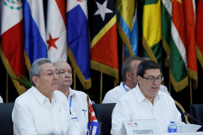Cuba's President Raul Castro (left) listens to Cuba's Foreign Minister Bruno Rodriguez during the opening of the Association of Caribbean States meeting in Havana, Cuba, on March 10, 2017. Photo: Reuters