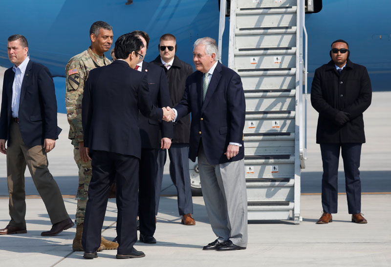 US Secretary of State Rex Tillerson shakes hands with officials upon his arrival at the Osan Air Base in Pyeongtaek, South Korea, on March 17, 2017. Photo: Reuters