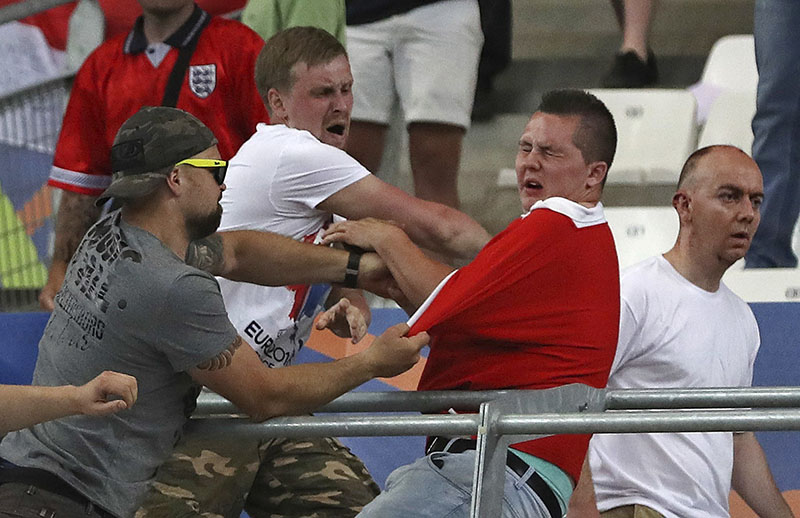 FILE - Russian supporters attack an England fan at the end of the Euro 2016 Group B soccer match between England and Russia, at the Velodrome stadium in Marseille, France, on Saturday, June 11, 2016. Photo: AP