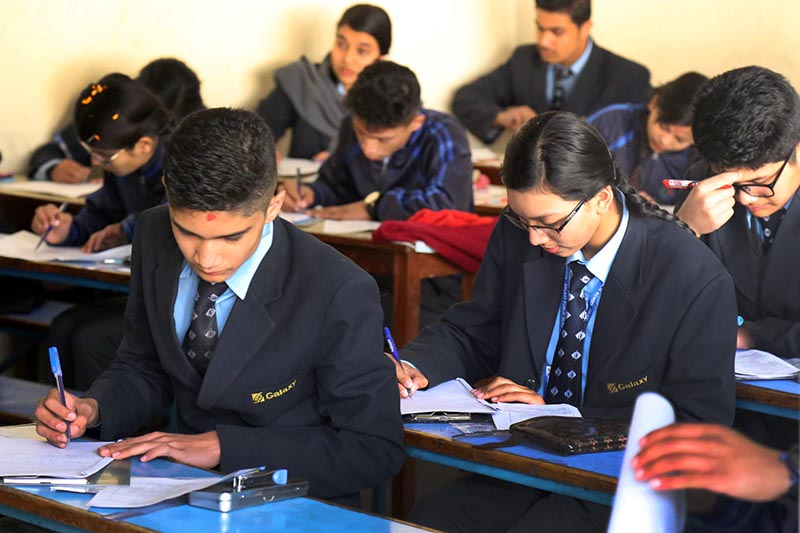 Students taking Secondary Education Examinations at a centre in Kathmandu on Thursday, March 16, 2017. Photo: THT