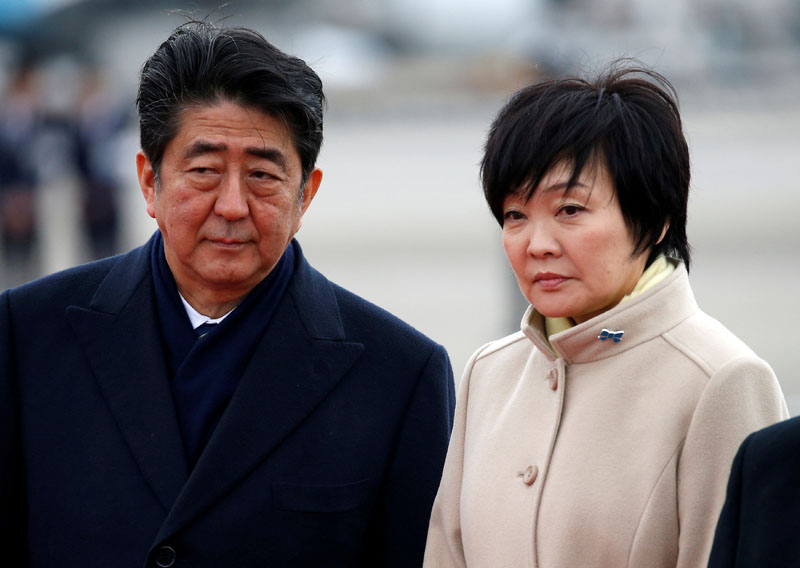 File - Japan's Prime Minister Shinzo Abe (left) and his wife Akie send off Emperor Akihito and Empress Michiko boarding a special flight for their visit to Vietnam and Thailand, at Haneda Airport in Tokyo, Japan February 28, 2017. Photo: Reuters