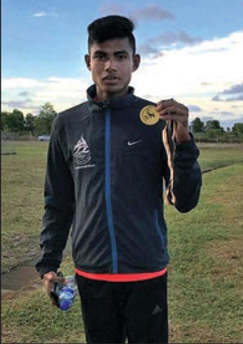 Nepalu2019s Som Bahadur Kumal shows the gold medal after winning the 800m race in Brunei Open Athletics Championship on Monday, March 20, 2017. Photo: THT