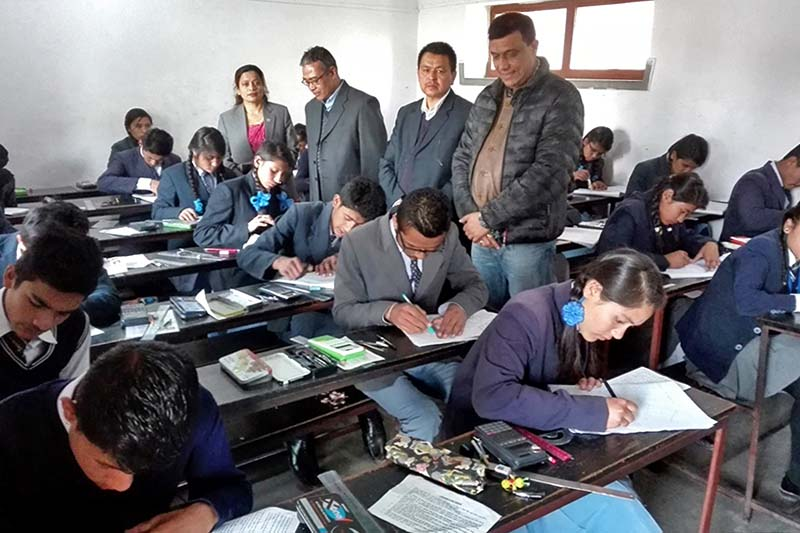 A team including State Minister for Education Dhanmaya BK (far left, standing) monitors the ongoing Secondary Education Examinations (SEE) at a school in Bhaktapur district, on Sunday, March 19, 2017. Photo: RSS