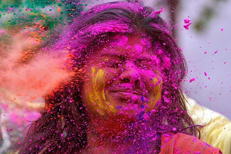 A college student reacts as coloured powder is thrown into her face during Holi, the Festival of Colours, celebrations in Agartala, India, on March 10, 2017. Photo: Reuters
