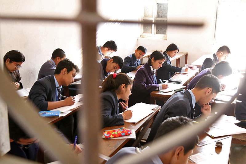 Students attend the Secondary Education Examinations at an examination centre in Kathmandu on Thursday, March 16, 2017. Photo: RSS