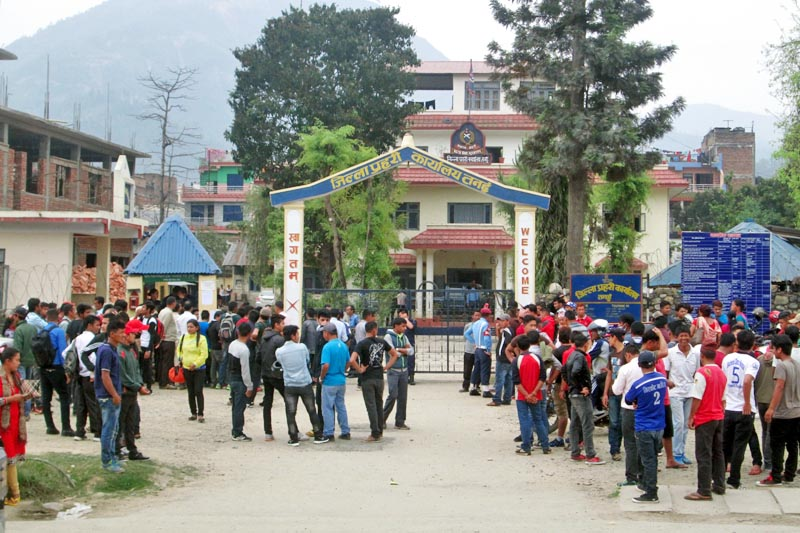 Youth throng the Tanahun District Police Office to gather information about the temporary police vacancies for the upcoming local level polls, in Damauli, on Friday, March 31, 2017. Photo: Madan Wagle
