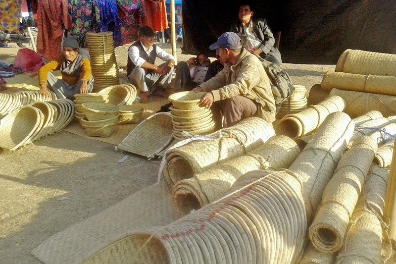 Vendors wait for customers to sell their traditioanl handicraft items at Gokuleshwor, a border town of Darchula and Baitadi districts, on Friday, March 3, 2017. Photo: RSS