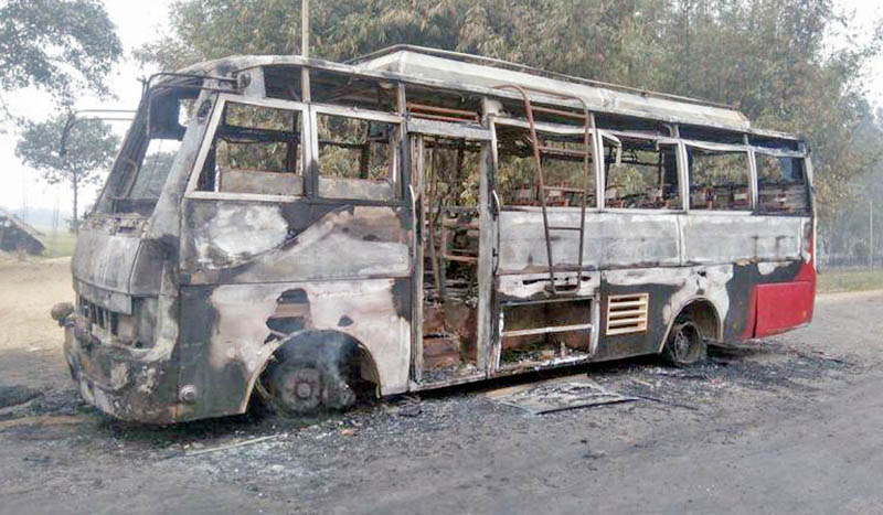 Wreckage of a bus burnt by the UDMF cadres along the Rajbiraj-Rupani road in Saptari district, on Friday, March 10, 2017. Photo: RSSn
