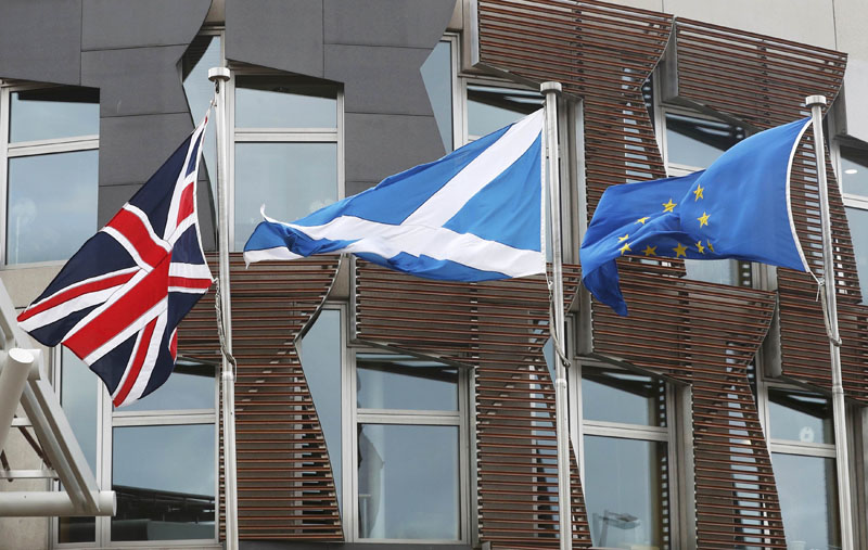 The Union Flag, The Saltire and the European flag fly outside the Scottish Parliament in Holyrood Edinburgh, Scotland, on March 13, 2017. Photo: Reuters