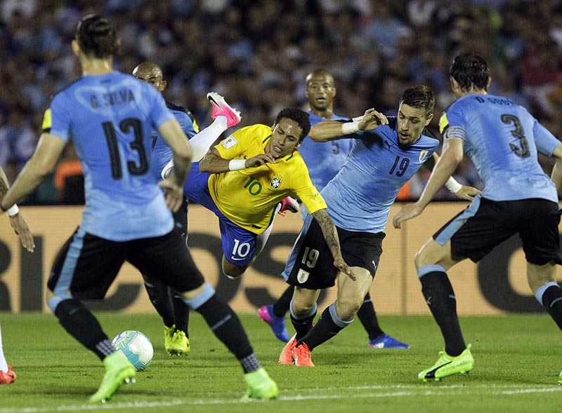 Brazil's Neymar (centre) fights for the ball with Uruguay's Sebastian Coates, second from right, during a 2018 World Cup qualifying soccer match in Montevideo, Uruguay, on Thursday, March 23, 2017. Photo: AP