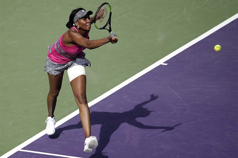 Venus Williams, of the United States, hits a return to Patricia Maria Tig, of Romania, during the Miami Open tennis tournament,in Key Biscayne, Florida, on Sunday, March 26, 2017. Photo: AP