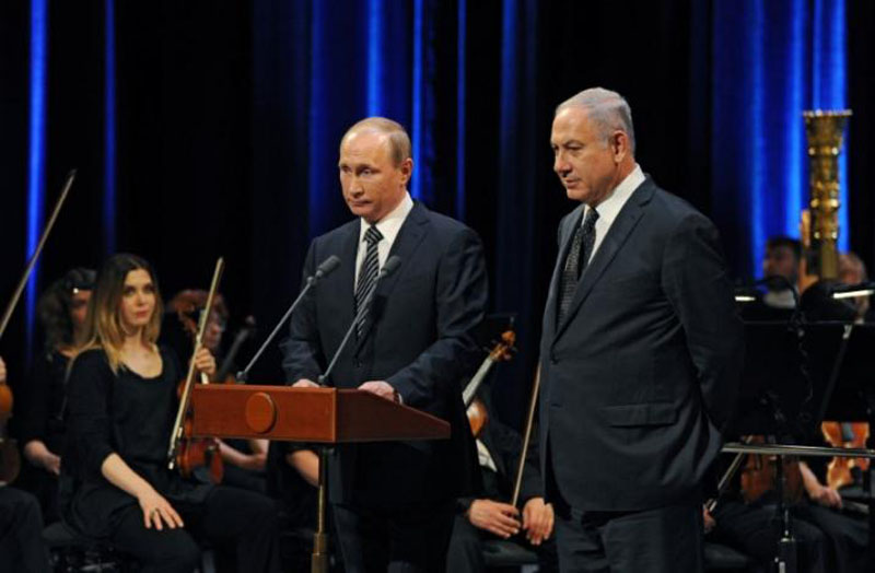 File - Russian President Vladimir Putin (L) and Israeli Prime Minister Benjamin Netanyahu attend a concert, dedicated to the 25th anniversary of the restoration of diplomatic relations between the two countries at the Bolshoi Theatre in Moscow, on June 7, 2016. Photo: Reuters