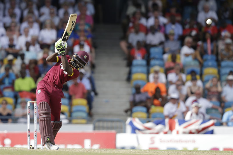 West Indies' Jonathan Carter hits a four from the bowling of England's Ben Stokes during their 3rd One Day International cricket match at the Kensington Oval in Bridgetown, Barbados, Thursday, March 9, 2017. Photo: AP