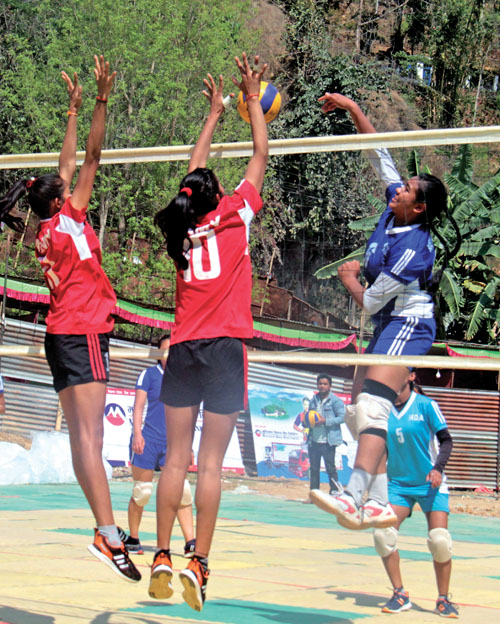 Pratibha Mali (right) of New Diamond goes up for a spike against TAC during their group-stage match of the first Didibahini Cup Women's Volleyball Tournament in Parbat on Thursday, March 9, 2017. Photo: THT