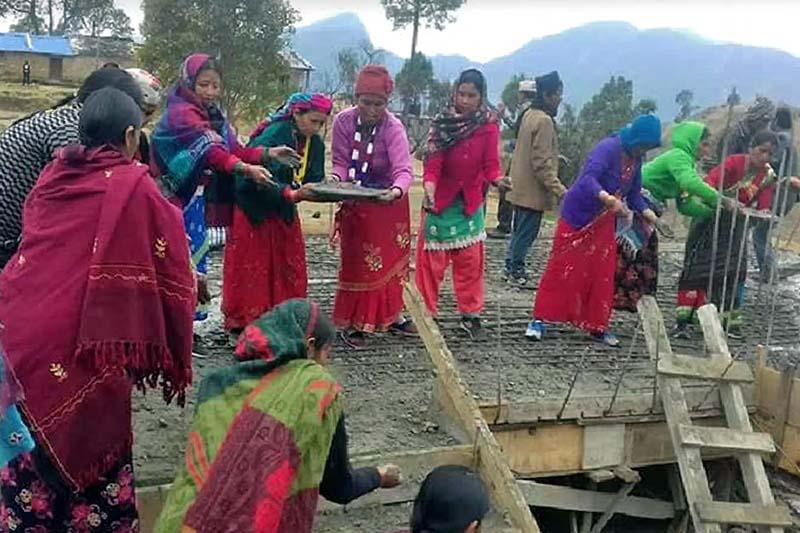 Women of Rajali in Badimalika Municipality-4 work to build the under-construction Choyakot Secondary School, in Bajura district on Wednesday, March 8, 2017. Photo: Prakash Singh