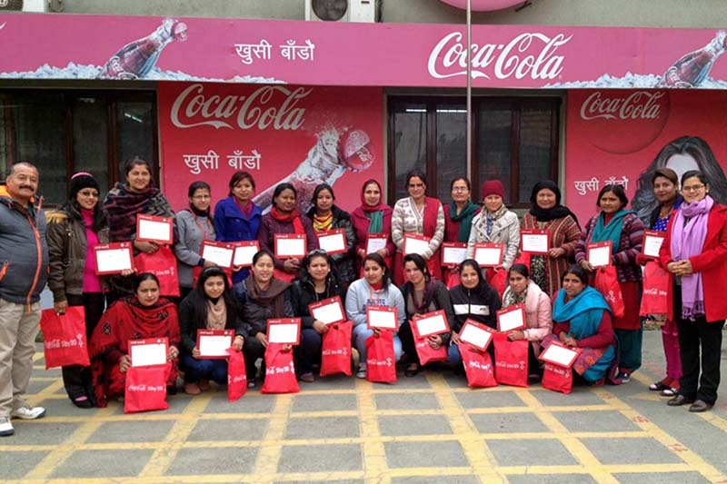 Women participate in Coca-Cola's global '5by20 initiative' on International Women's Day