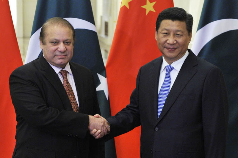FILE - In this Nov. 8, 2014 file-pool photo, Pakistani Prime Minister Nawaz Sharif, left, and Chinese President Xi Jinping shake hands before their meeting at the Great Hall of the People in Beijing, China. Photo: AP