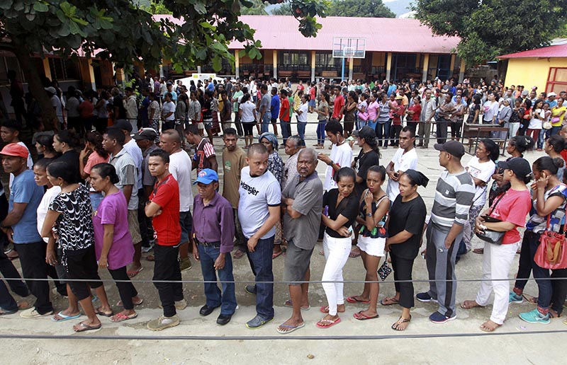 People queue up to give their vote during the presidential election at a polling station in Dili, East Timor, Monday, on March 20, 2017. Photo: AP