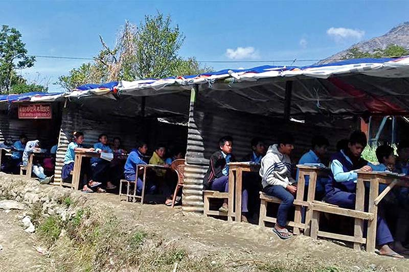 Students of the recently destroyed Balmandir Primary School are seen taking exam under the tent at Dandakhet, Beni municipality-4, Myagdi, on March 23, 2017. The school was gutted in a blaze recently due to a electrical short circuit. Photo: RSS