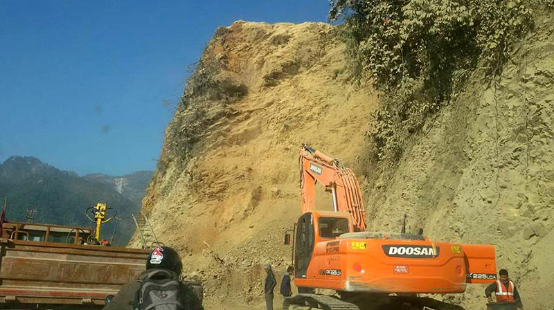 An excavator is seen by the roadside of Narayangadh-Muglin road section, in Chitwan district, on Tuesday, March 21, 2017. Photo: Tilak Ram Rimal