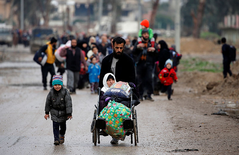 Displaced Iraqi people from different areas in Mosul flee their homes after clashes to reach safe areas, as Iraqi forces battle with Islamic State militants in the city of Mosul, Iraq, on March 18, 2017. Photo: Reuters