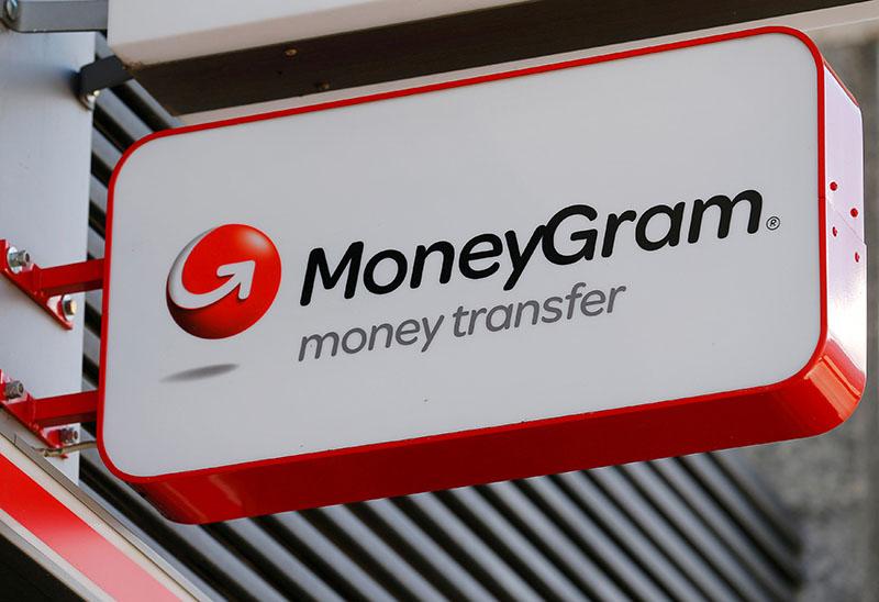 A Moneygram logo is seen outside a bank in Vienna, Austria, on June 28, 2016. Photo: Reuters