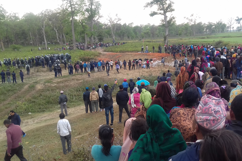 Locals and security personnel gather near the Nepal-India border in Punarbas-8 of Kanchanpur district after Indian security personnel shot a Nepali man dead, on Thursday, March 9, 2017. Photo: Tekendra Deuba