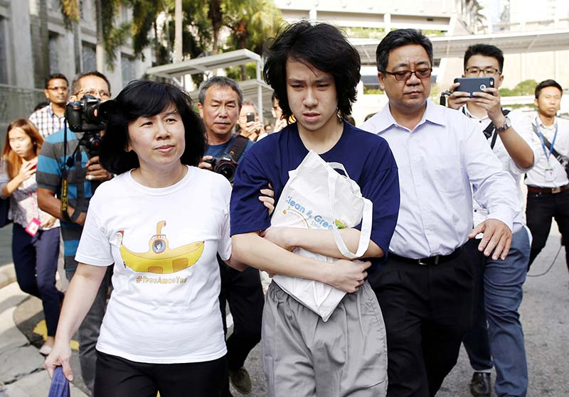 FILE-Teen blogger Amos Yee leaves with his parents after his sentencing from the State Court in Singapore, on July 6, 2015. Photo: Reuters