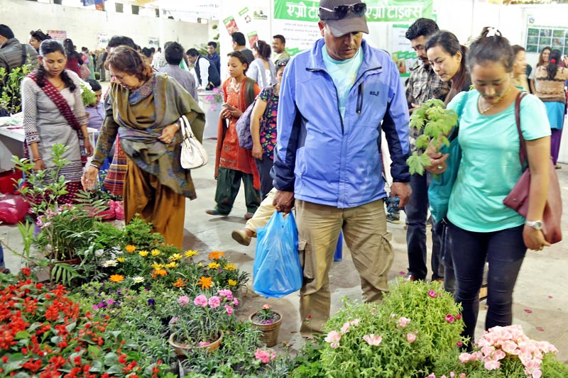 People are seen visiting a flower stall during the ongoing 3rd International Flora Expo in Bhrikutimandap, Kathmandu, on Sunday, April 2, 2017. Photo: RSS