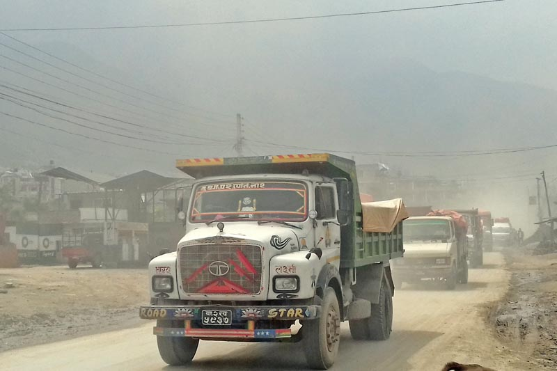 Vehicles seen plying amid dust, along Kalanki-Nagdhunga road section in Changragiri Municipality, on the western outskirs of Kathmandu, on Friday, April 21, 2017. The on-going road expansion project have created traffic jams and air pollution in the area. Photo: Mausam Shah Nepali