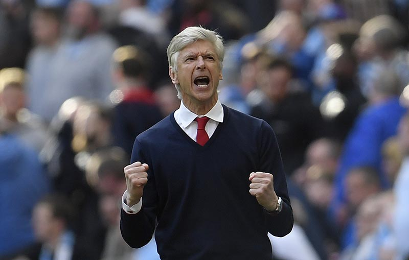 Arsenal manager Arsene Wenger celebrates after the match. Photo: Reuters