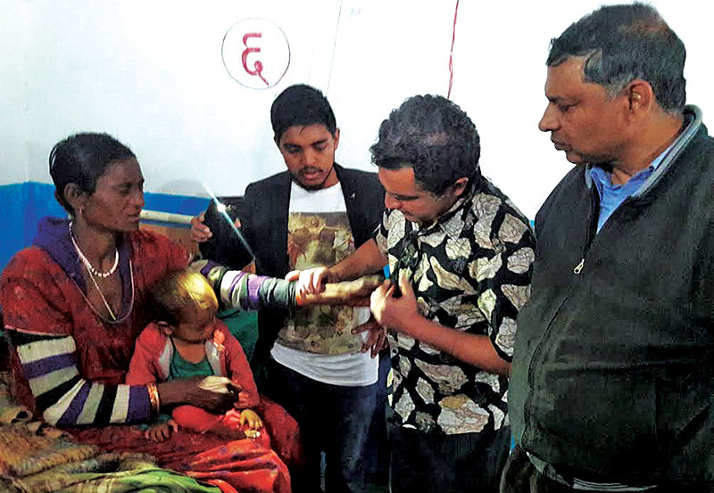 A patient being examined at a health camp, in Bajura, on Saturday, April 01, 2017. Photo: THT