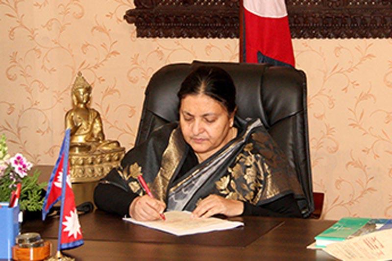 President Bidya Devi Bhandari authenticates various bills endorsed by the Legislature-Parliament, in Kathmandu, on Sunday, April 23, 2017. Courtesy: President's Office