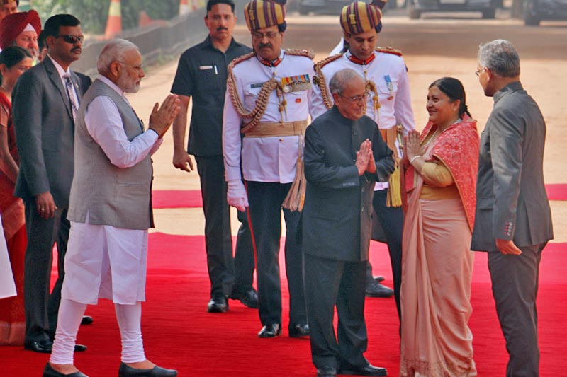 Nepal's President Bidya Devi Bhandari, who is on a five-day official visit to India, being welcomed by her counterpart and PM Narendra Modi after receiving a guard of honour at Rastrapati Bhawan, in New Delhi, India, on Tuesday, April 18, 2017. Photo: RSS