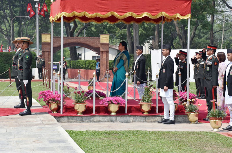 President Bidya Devi Bhandari receives a guard of honour before leaving for India for an state visit, at the Tribhuvan International Airport, in Kathmandu, on Monday, April 17, 2017. Photo: RSS