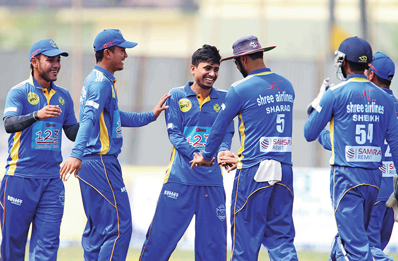 Biratnagar Kingsu2019 Sushil Kandel (centre) celebrates with teammates after taking a wicket against Kanchanpur Iconic during their Sagarmatha Cement DPL match at the SSP Cricket Ground on Saturday.Photo: Udipt Singh Chhetry