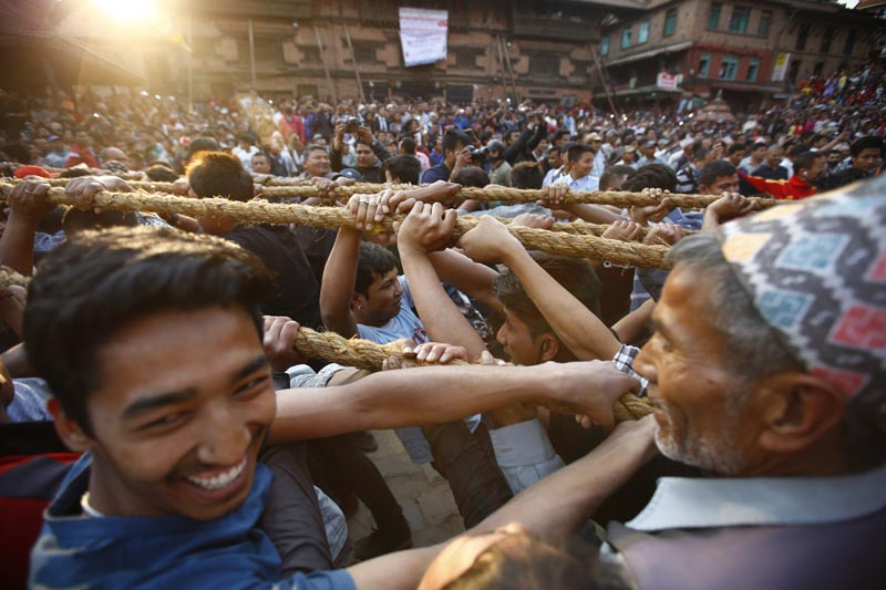 Revellers pull ropes attached to a chariot carrying Lord Bhairav's idol during celebrations on the first day of Bisket Jatra festival in Bhaktapur on April 10, 2017. Photo: Skanda Gautam