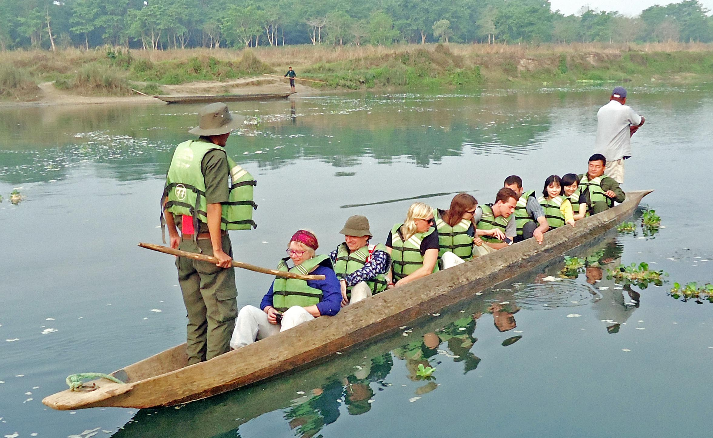Tourists enjoy boating in Rapti River at Sauraha in the Chitwan National Park in Chitwan district, on Sunday, April 2, 2017. Photo: Rishi Ram Baral