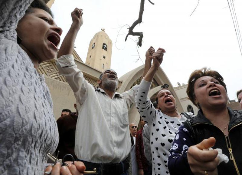 Relatives of victims react in front of a Coptic church that was bombed on Sunday in Tanta, Egypt, April 9, 2017. Photo: Reuters