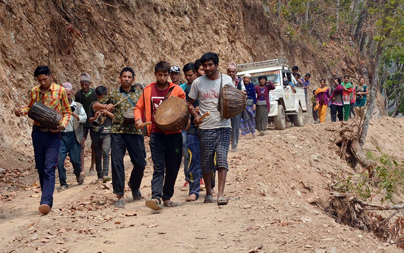 Local residents of Jaidi in Jaimini-7 play musical instruments to welcome a vehicle in Boraka village of Baglung district, on Monday, April 20, 2017. With the construction of road, the vehicle reaches the rural Baglung village for the first time. Photo: RSS