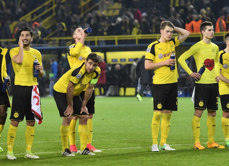 Dortmund's Nuri Sahin, Sokratis Papastathopoulos, Lukasz Piszczek, Matthias Ginter and Julian Weigl, from left, react after losing 2-3 during the Champions League quarterfinal first leg soccer match between Borussia Dortmund and AS Monaco in Dortmund, Germany, on Wednesday, April 12, 2017. Photo: AP