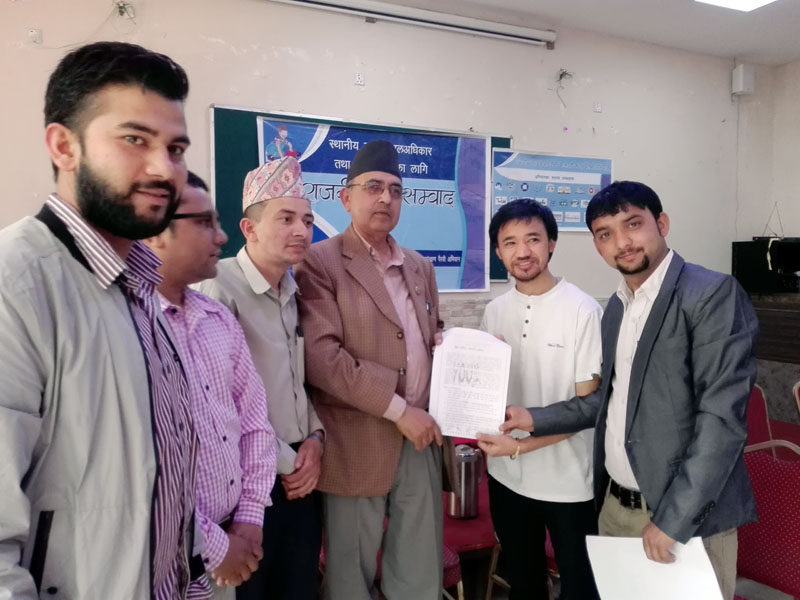 Youth activists submit a memorandum to CPN-ML General Secretary CP Mainali, in the run-up to the local level elections in Kathmandu, on Wednesday, April 19, 2017. Photo courtesy: Deepak Sunuwar